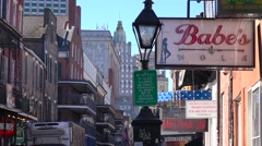 Establishing shot of Bourbon Street sign, French Quarter, New Orleans day. Stock Footage