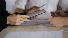 Close-up view of people working with blueprints making corrections Stock Footage