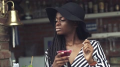Gorgeous african american business lady drinking cocktail at bar Stock Footage