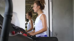 Woman Training on Treadmill in Gym. Active Lifestyle and Workout Concept. Stock Footage