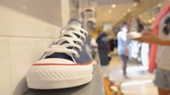 Closeup on Sneakers or Gumshoes in Shoe Shop. Stock Footage