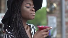 Gorgeous african american business lady drinking cocktail at bar and enjoying Stock Footage