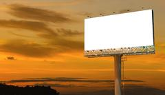Blank billboard ready for new advertisement with sunset background Stock Photos