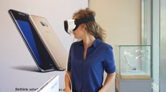 Woman Wearing Samsung Gear VR Glasses for Mobile Phone Stock Footage