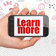 Education concept: Hand Holding Smartphone with Learn More on display Stock Illustration