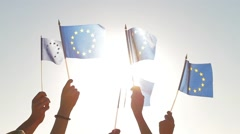 Hands waving EU flags. Stock Footage