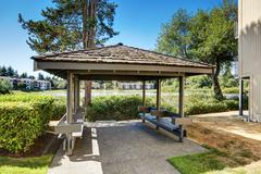 Condo apartment homes overlooking a small lake with a gazebo. Northwest, USA, Stock Photos
