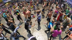 Crowds of People Celebrating Songkran Festival at Road Arkistovideo