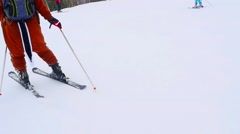 People on slope at ski resort in snowstorm and blizzard. 1920x1080 Stock Footage