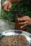 Manual coffee grinder with coffee beans - stock photo