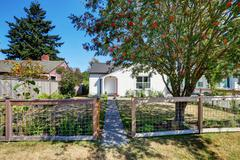 Small white rambler house with concrete walkway. Northwest, USA Stock Photos