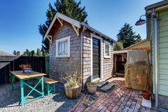 Small shed in the back yard of American rambler house. Northwest, USA Stock Photos
