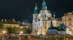 Baroque St. Nicholas' Cathedral on the Oldtown Square in Prague with monument Stock Footage