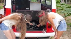 Two Hipster Girls with Broken Hippie Minibus on Road. Stock Footage