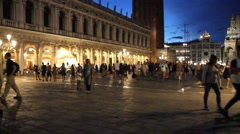 Tourists walking in the Saint Marks square during the night, Venice Stock Footage