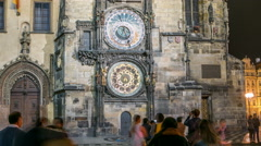 Night view of the medieval astronomical clock in the Old Town square timelapse Stock Footage