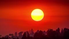 Big sunset sun orange sky setting over Hollywood Hills 4K timelapse background Stock Footage