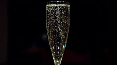 SPARKLING WINE IN GLASS SCARBOROUGH ENGLAND Stock Footage