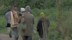 Man holding in arms child who drop down baby doll, poor family walk slow motion. Stock Footage