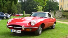 Jaguar E-Type Roadster classic English sports car Stock Footage