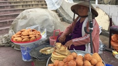 Vietnamese senior cookies seller Stock Footage