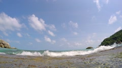 Foamy Sea Water Hitting Thai Beach against Blue Sky. 2.7k Stock Footage