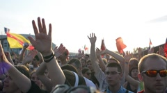 People clap and wave their Hands and dancing at a Gospel Rock Concert Stock Footage