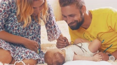 Young parents playing with little baby. Family. Happy father and mother. Love - stock footage