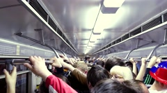 Russia, Novosibirsk, 9 may 2015. People standing inside a busy subway. 4k Stock Footage