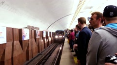Russia, Novosibirsk, 9 may 2015. Crowd of passengers enter and exit a subway Stock Footage