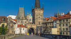 A view along Charles Bridge in Prague towards the Lesser Quarter in the morning Stock Footage