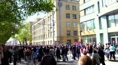 Russia, Novosibirsk, 9 may 2015. Anonymous people walking in a crowded street Stock Footage