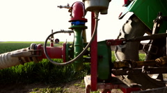 Tractor pump for field irrigation. Stock Footage