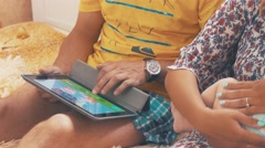 Parents home with baby. Family. Father play in tablet. Mother lull child. Happy - stock footage