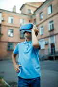 Fascinated little boy using VR virtual reality goggles. outdoor Stock Photos