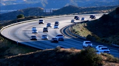 Freeway traffic ,Trucks and cars on the  freeway in Cajon Pass Ca Stock Footage