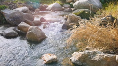 Big rock in canal with flare Stock Footage