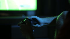 Teen playing on a games console at night Stock Footage