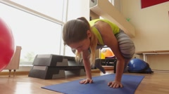 Young girl performs asanas Hansasana (swan pose) in the gym. Stock Footage