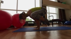 Sport, young girl performs posture Crane (Bakasana). Stock Footage