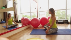 Beautiful athletic girl sits in a lotus position. Stock Footage