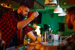 Making alcohol cocktail Stock Photos