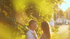 The man blonde gently runs his fingers across the long hair of a girl. Stock Footage
