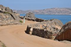 Road to the camp site on Shark Island, Luderitz Stock Photos