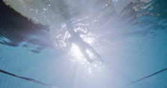 View from underneath a handsome male swimmer underwater Stock Footage