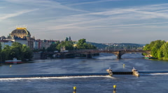 Vltava river timelapse in district Strelecky ostrov with the bridge of the Stock Footage