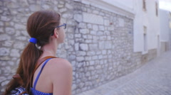 Woman walk through streets of historical town Nin 4K Stock Footage