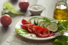 Salad of tomatoes, cucumbers, lettuce and onion Stock Photos
