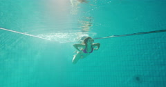 Happy and attractive couple swimming together underwater Stock Footage