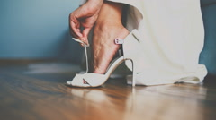 Bride's wedding shoes decorated with rhinestones on the wooden floor Stock Footage